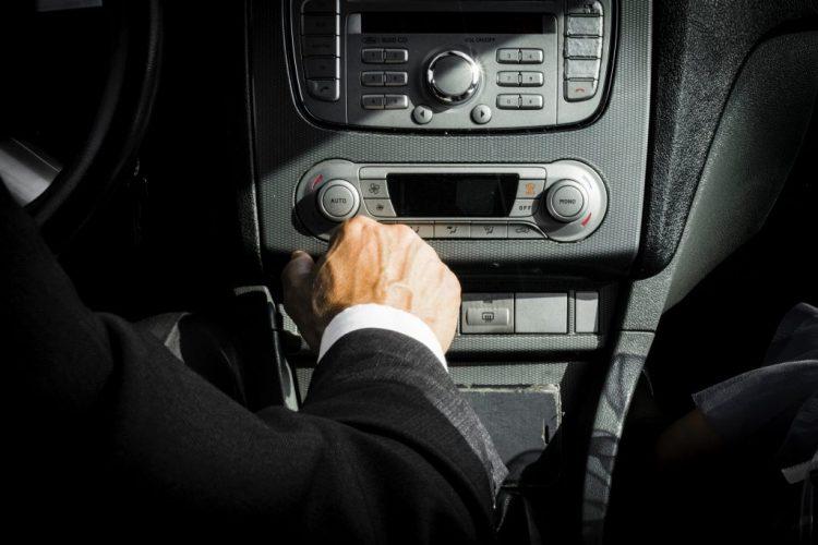 moviman-in-black-suit-inside-car-1135379-1024x683