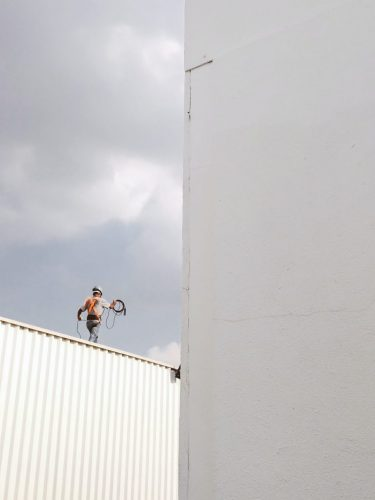 moviman-walking-on-roof-top-2317640-scaled-e1593260759327-768x1024
